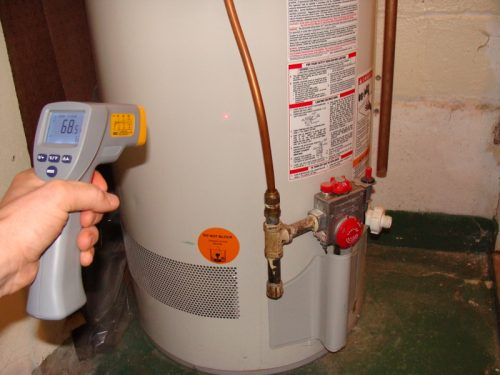 Infrared thermometer pointed at water heater