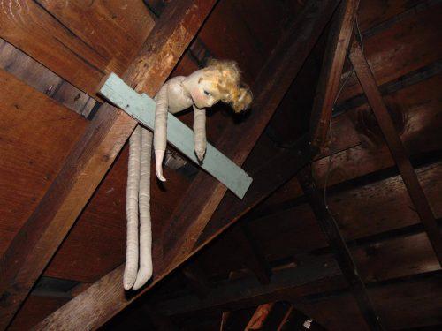 Creepy doll in attic