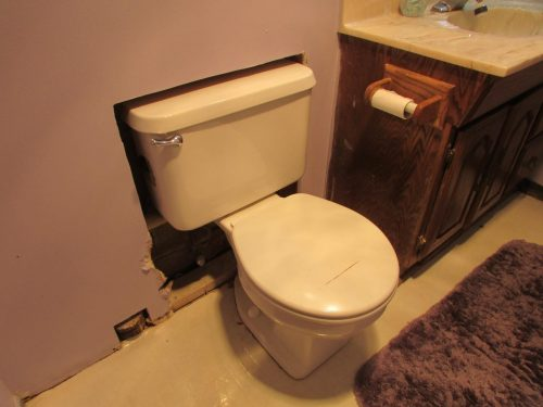 Toilet recessed into wall
