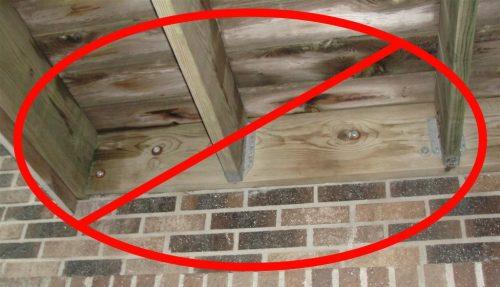 Deck attached through brick veneer
