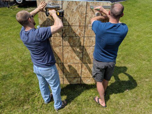 Joe and Matt building a wall