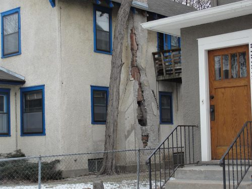 Stucco-covered chimney damage