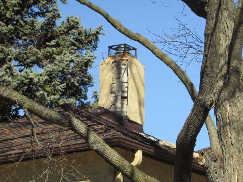 Stucco covered-chimney damage
