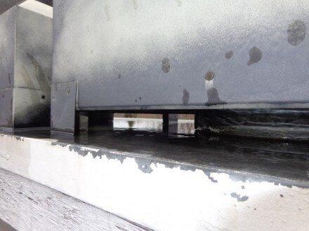 Water on metal chimney cap