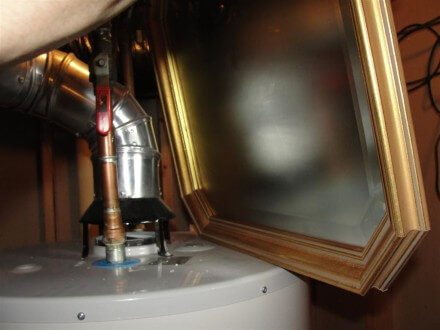 Mirror at backdrafting water heater