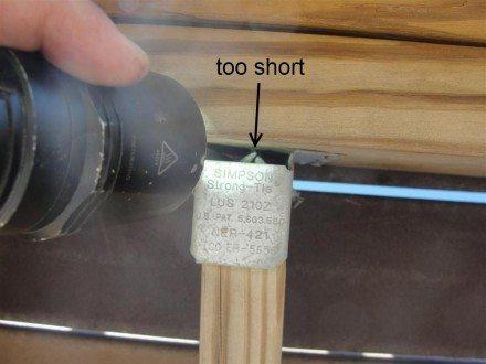 Decks - short nails at joist hanger labeled