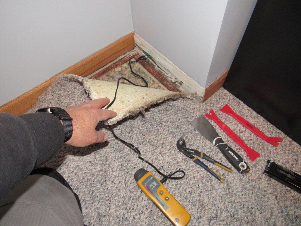 Moisture testing wood foundation before.JPG
