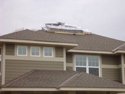 Shingles Delivered on top of brand new roof