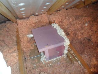 Insulated box over recessed light