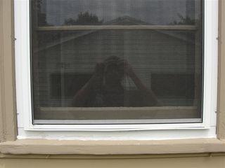 Caulk at base of storm window
