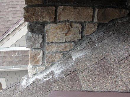 Stone siding too close to shingles