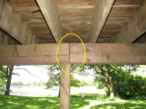 Beam splice not over post at deck