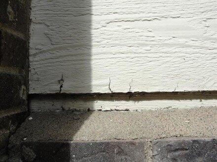 Cracked hardboard siding