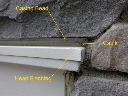 Exterior - Caulked head flashing