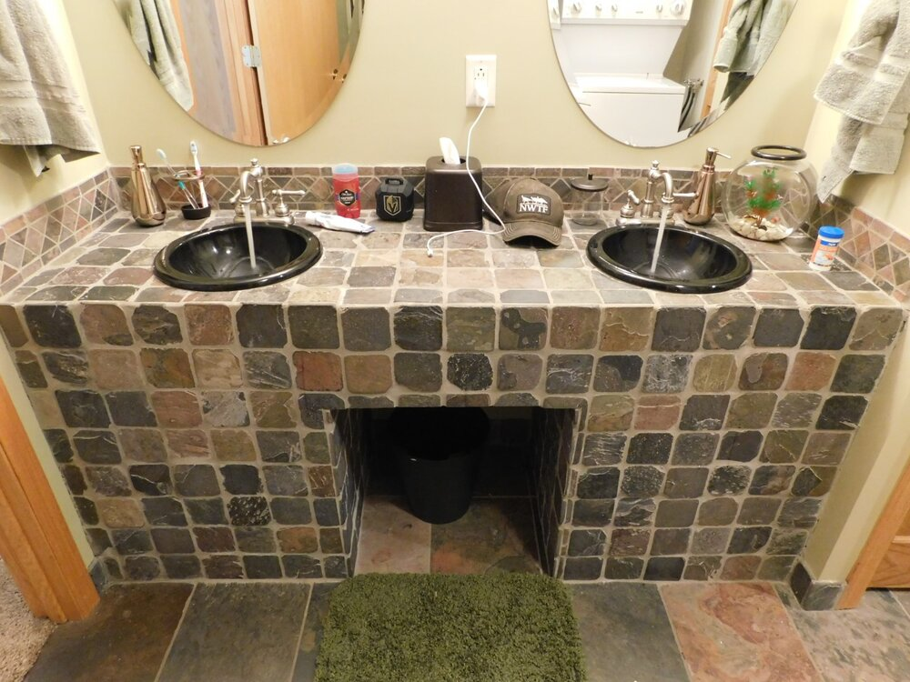 DIY vanity. Let's hope someone got those drain connections right, because there is no way to access anything underneath it.