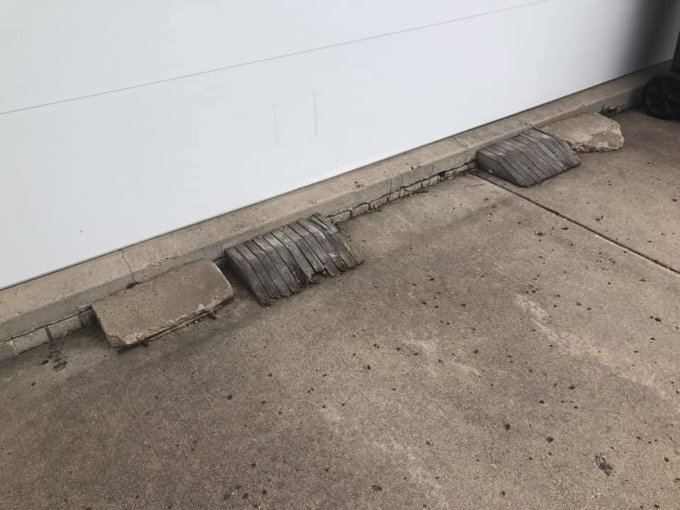 """Quite the interesting solution to a settled driveway. And when we Minnesotans say """"interesting"""", we don't mean interesting."""
