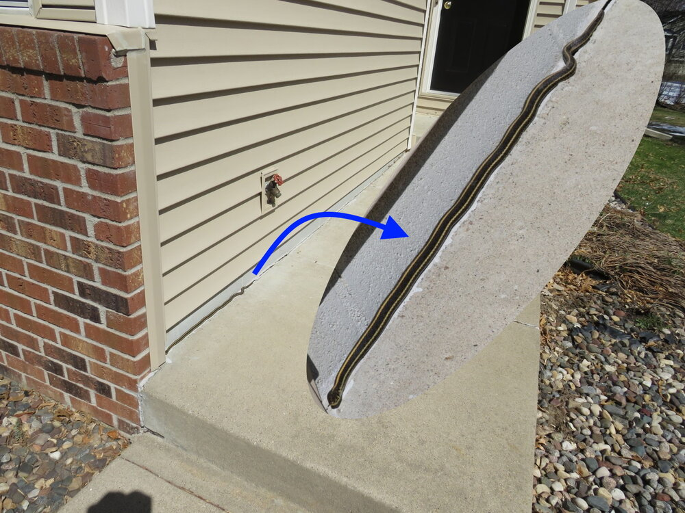 """The last home inspector's report, we're assuming: """"There was a gap between the sidewalk and the foundation. Install a garter snake, if necessary, and fill the gap with a polyurethane caulk to help prevent water intrusion between the sidewalk and foundation."""""""