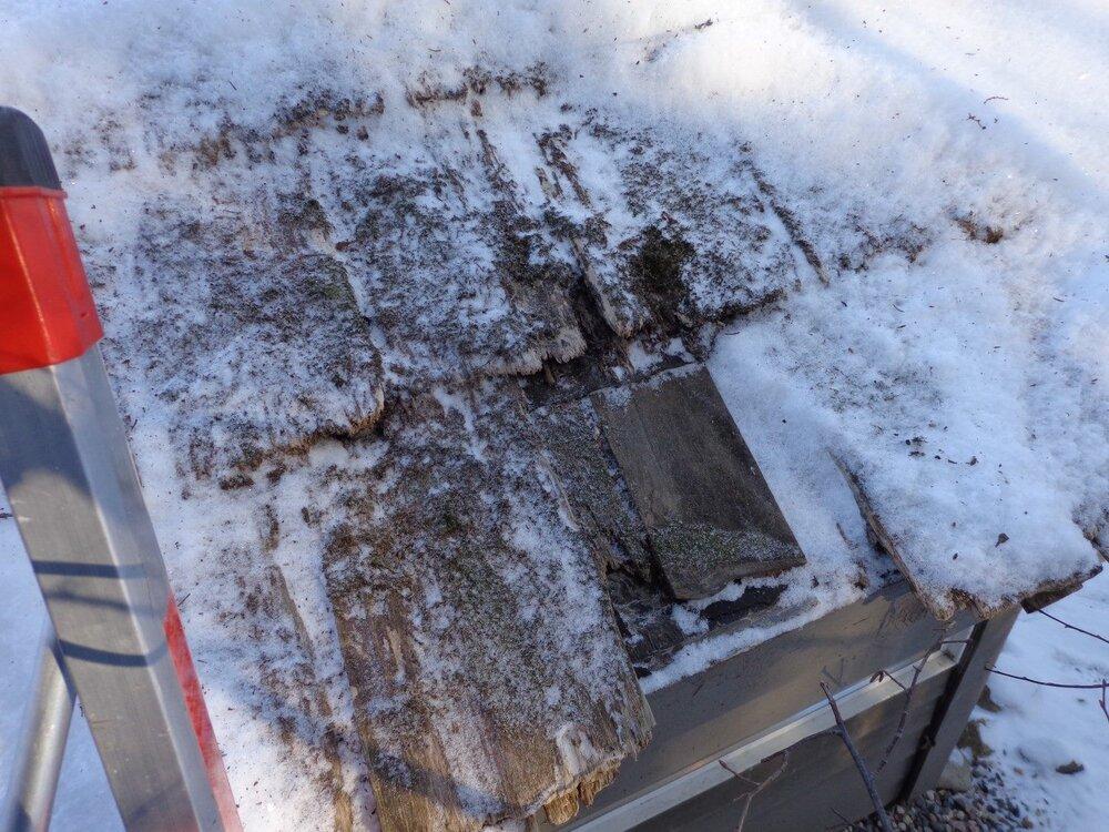 Trashed roof below snow.jpg