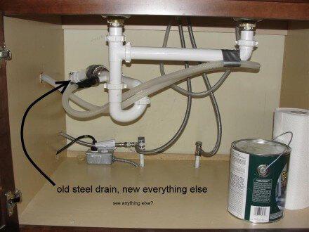 old steel drain at kitchen sink